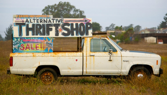 van with thrift shop sign