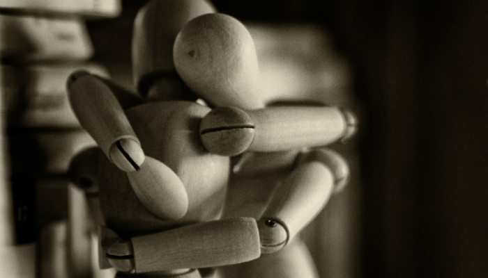 wooden dolls embrace